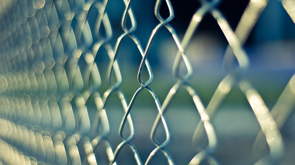 Chain link fence in soft focus